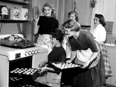 Women baking and eating cookies, Minneapolis 1954